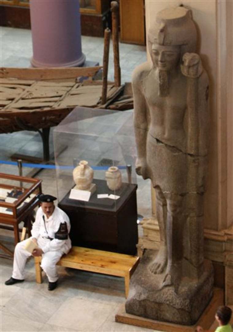 A police officer stands guard by a Pharaonic statue at the Egyptian Museum in Cairo, Egypt Tuesday, Aug. 24, 2010. Security for Egypt's cultural treasures is under scrutiny after the Aug. 21, 2010 theft of a van Gogh painting from Cairo's Mahmoud Khalil Museum museum revealed some alarming gaps.