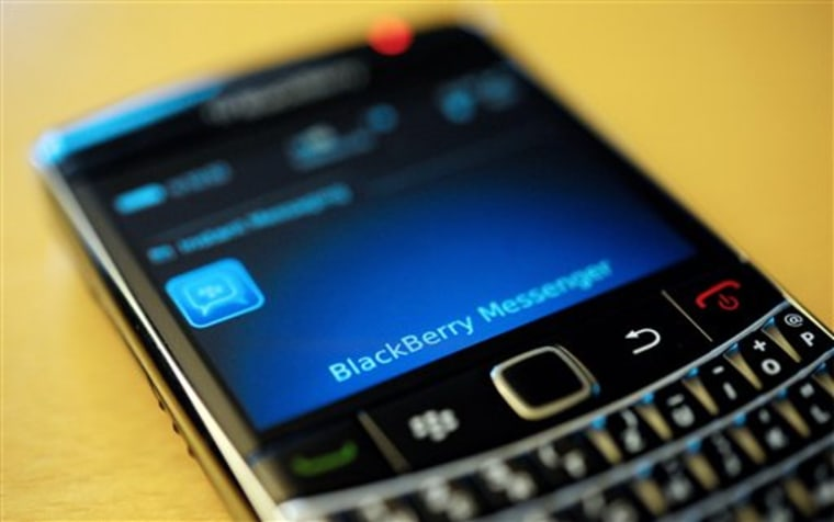 "A BlackBerry smartphone using its ""Messenger"" service."