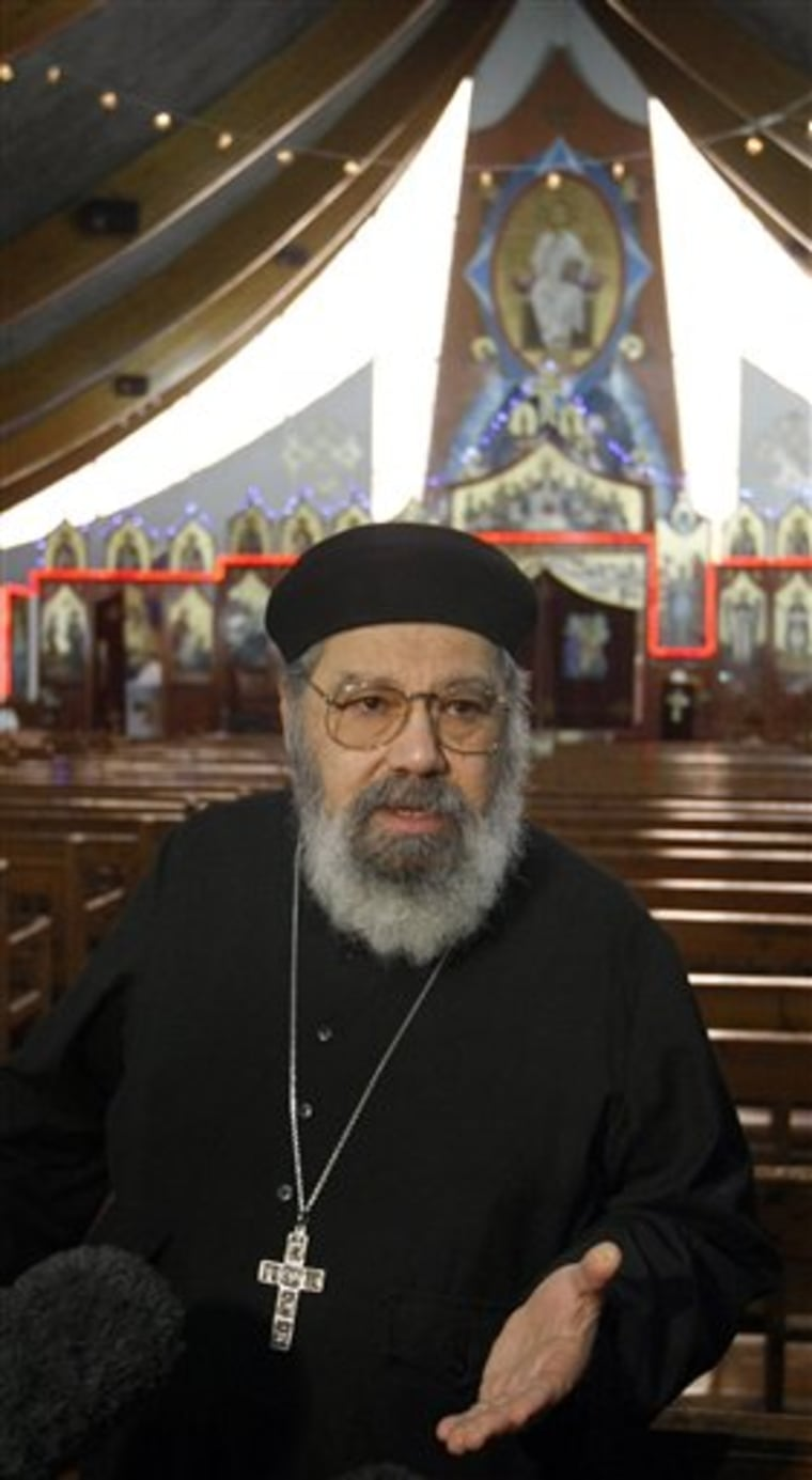 Father Girguis Lucas addresses reporters inside the Coptic church Sainte Marie Saint Marc of Chatenay-Malabry, south of Paris, Tuesday. Messages of threats against Coptic churches were seen on the Internet by a member of the congregation.