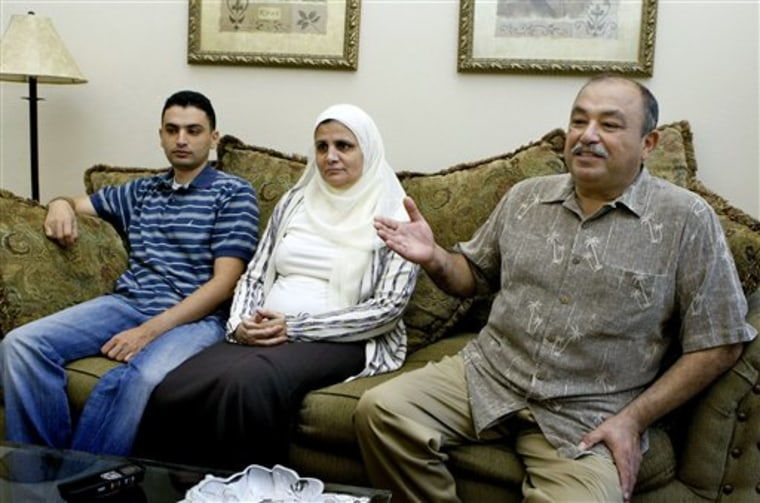 Samir Megahed, right, his wife, Ahlam, center, and son Yahia took the oath of U.S. citizenship Friday, three days before his adoptive country tries to throw out one of his sons, Youssef Megahed, as a suspected terrorist.