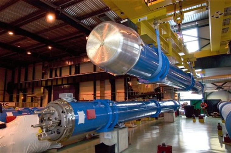 The first superconducting magnets for the Large Hadron Collider are put into placeat CERN in Geneva.