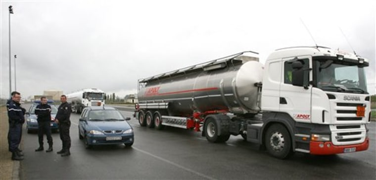 A full tanker truck leaves a fuel depot near the oil refinery of Donges, western France, on Saturday. The refinery remains closed but police cleared access to the fuel depot. Travelers in France are facing another day of spotty train service and gas shortages as strikes against the government's pension reform enter their twelfth straight day.