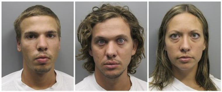 From left, Ryan Edward Dougherty, 21, Dylan Dougherty Stanley, 26, and Lee Grace Dougherty, 29 following their arrest in Colorado.