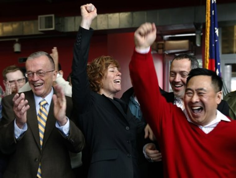 "Retired Navy commander Zoe Dunning, center, celebrates the vote by the U.S. Senate at the LGBT Center in San Francisco, Calif., on Saturday. The Senate agreed on Saturday to do away with the military's 17-year ban on openly gay troops and sent President Barack Obama legislation to overturn the Clinton-era policy known as ""don't ask, don't tell."" For Dunning, the vote ended a long struggle that included two military discharge hearings after she declared she was gay."