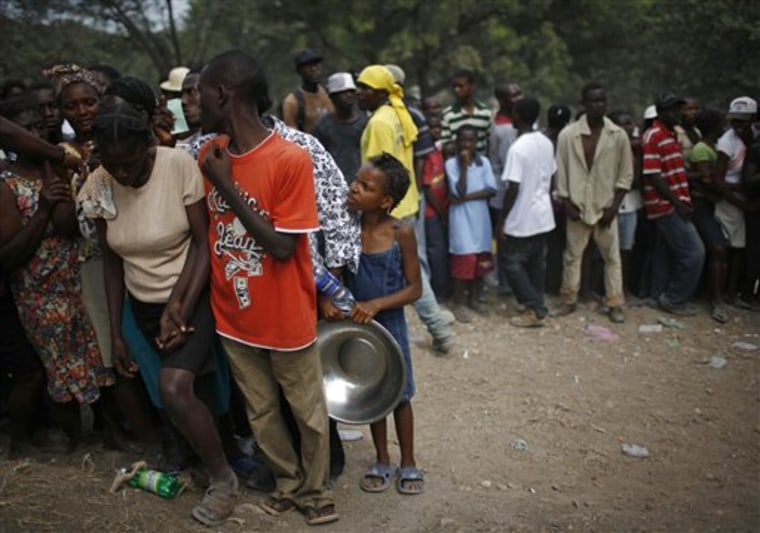 People wait in line for food rations in the aftermath of the Jan. 12 earthquake in Port-au-Prince on Wednesday.