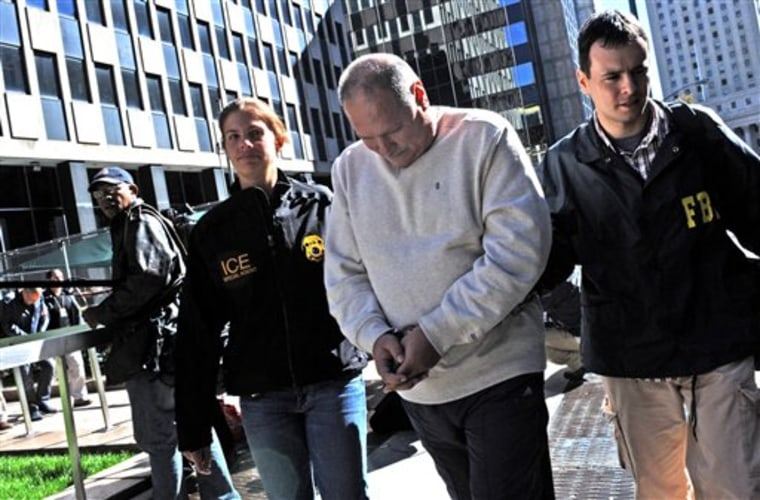 Michael Dobrushin is led in handcuffs from FBI headquarters in New York. Dobrushin is one of 73 people across the country charged by federal prosecutors in a scheme to cheat Medicare out of $163 million, the largest fraud by one criminal enterprise in the program's history, U.S. authorities said.