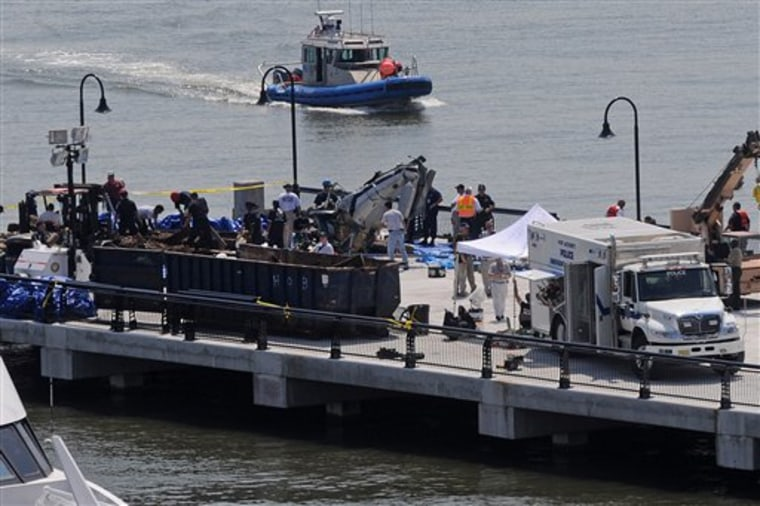The wreckage of a helicopter that collided with a private plane is seen Aug. 10, 2009, on a Hoboken, N.J., pier.
