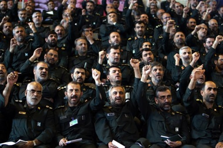 Iranian Revolutionary Guard commanders chant slogans during a September 2007 meeting with President Mahmoud Ahmadinejad, not pictured, in Tehran, Iran.