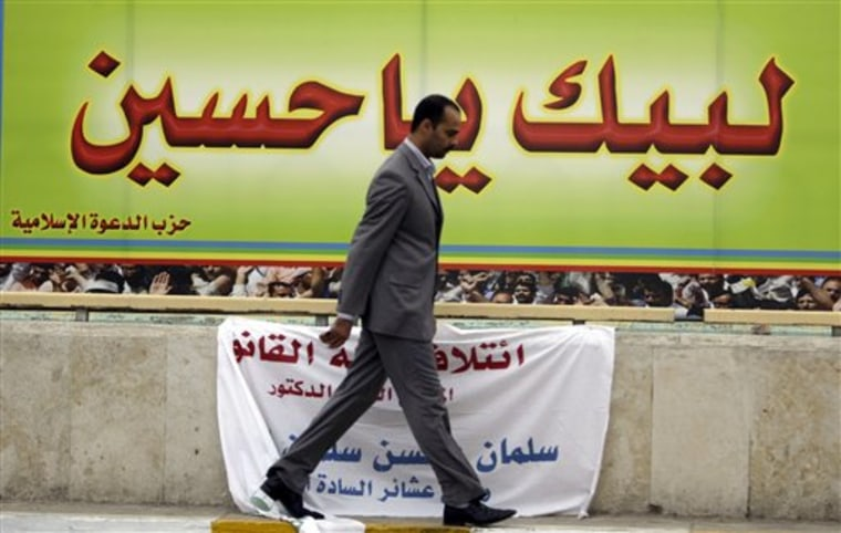 "Iraqi man walks past a campaign poster for Shiite Dawa Party reading in Arabic ""Oh, Hussein, here we come to your aid,"" in Baghdad, Iraq, on Feb. 16. Election campaigning is only stoking Iraq's political tensions. Thousands of campaign posters and banners around the city play to potentially explosive sectarian resentments, with Shiites pointing to Sunnis as loyal to Saddam Hussein or al-Qaida and Sunnis depicting Shiites as oppressing their community."