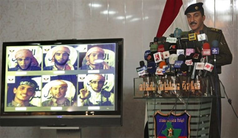 Iraqi military spokesman Maj. Gen. Qassim al-Moussawi, right, stands next to a television display showing a recording of six alleged foreign fighters in Baghdad, Iraq, on Sunday. Al-Moussawi says security forces are on the lookout for six foreign fighters who helped launch horrific attacks this year that killed more than 140 people.