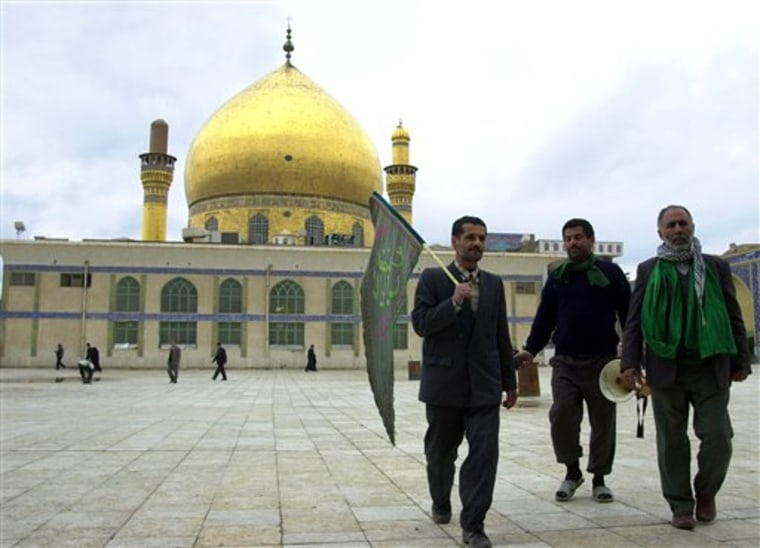 Pilgrims walk in front of the famous al-Askari mosque in Samarra, Iraq, on Feb. 2, 2004. A car bomb killed eight pilgrims Thursday, Feb. 10, on the road to one of Iraq's holiest Shiite shrines, a highly sensitive site still being rebuilt after a 2006 attack that sheered off its gleaming golden dome and engulfed the country in years of sectarian bloodshed.
