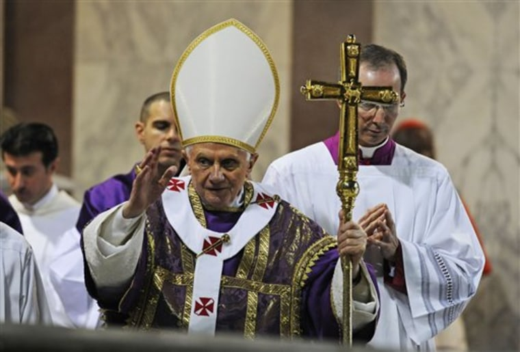 Pope Benedict XVI salutes the faithful during the traditional Ash Wednesday mass in the St. Sabina church in Rome Wednesday, March 9.