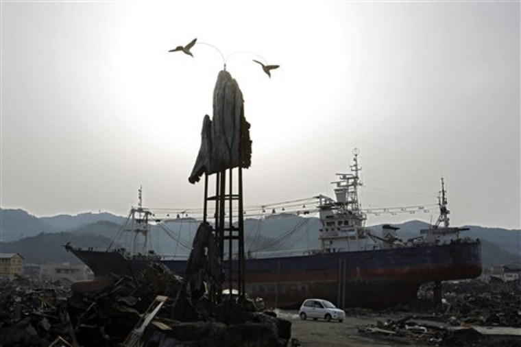 The day after tomorrow? A grounded ship is perched amid tsunami debris in the port town of Kesennuma, Miyagi prefecture, Japan, on April 11.