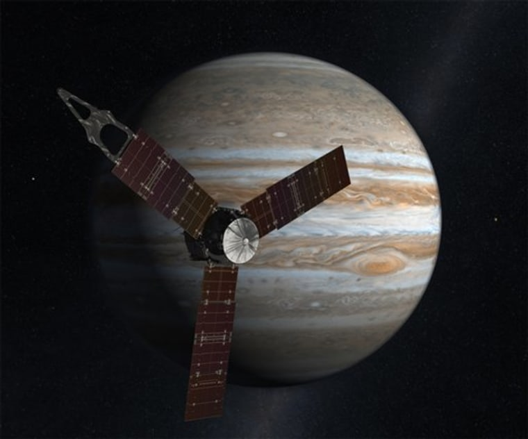 This artist's rendering shows the Juno spacecraft circling Jupiter. On Thursday, the spacecraft executed the first of two engine burns aimed at setting itself up for an Earth gravity assist next year. It's due to arrive at Jupiter in 2016.