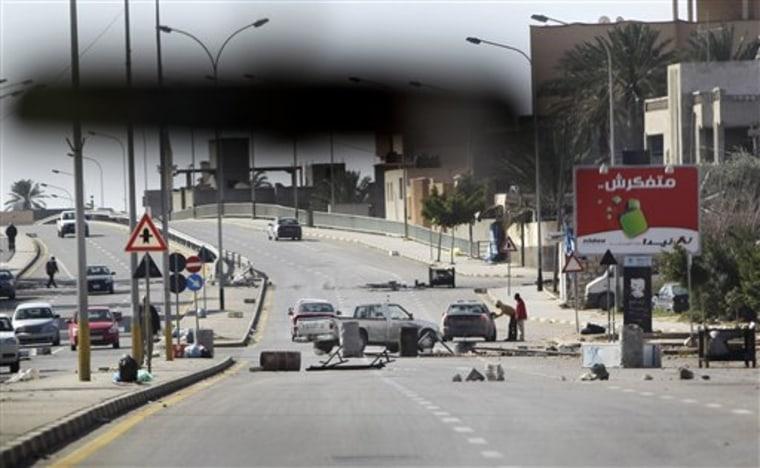An impromptu roadblock is seen through a car windscreen in Tripoli, on Saturday.