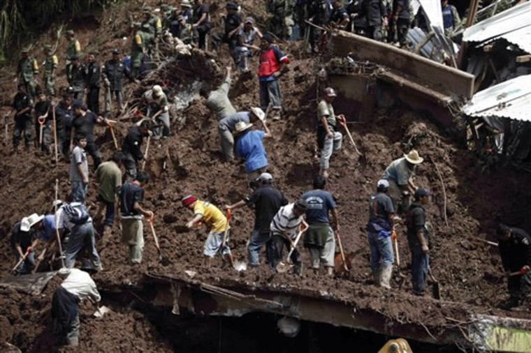 Soldiers, police officers and residents search for victims Wednesday after the landslide Santa Maria Tlahuitoltepec, Mexico.