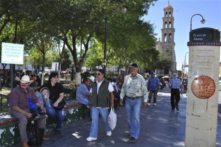 Pedestrians walk in a town square Oct. 12 in Ciudad Juarez, Mexico. The city is planning a 16-day festival to show the world that its crime rate is declining.