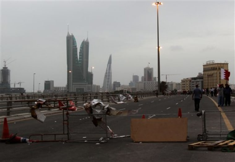 A barricade set up by Bahraini anti-government protesters Sunday, March 13, 2011, prevents traffic from entering the capital of Manama.
