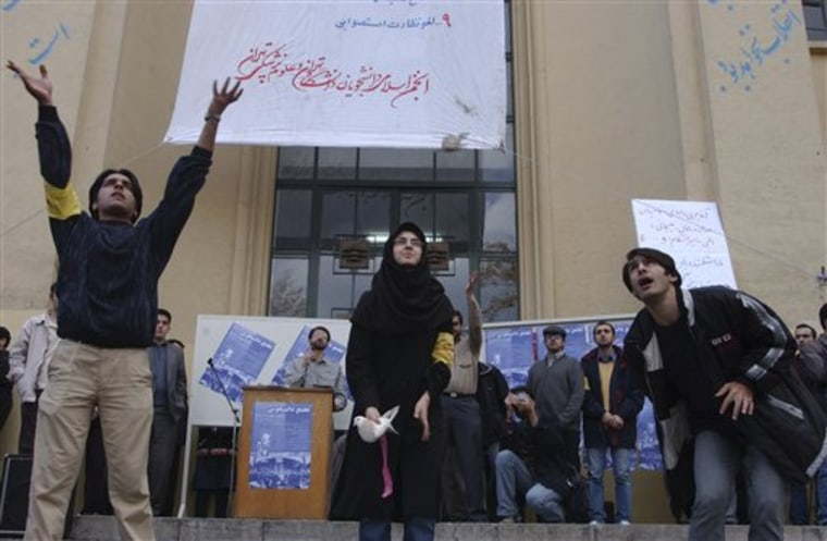 A female Iranian university student, center, and two male students release pigeons during a gathering to mark the national annual Student Day, at Tehran University campus in Iran, on Dec. 7, 2003. Iranian President Mahmoud Ahmadinejad, reviled by the opposition as a figurehead of hard-line rule, is now temporarily in the reformists corner by opposing plans to segregate male and female students at Iranian universities.
