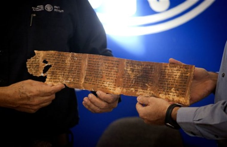 A copy of a part of the Dead Sea Scrolls is presented during a joint Israel Antiquities Authority-Google news conference in Jerusalem on Tuesday. Israeli authorities have put 5,000 fragments of the ancient Dead Sea scrolls online in a partnership with Google.