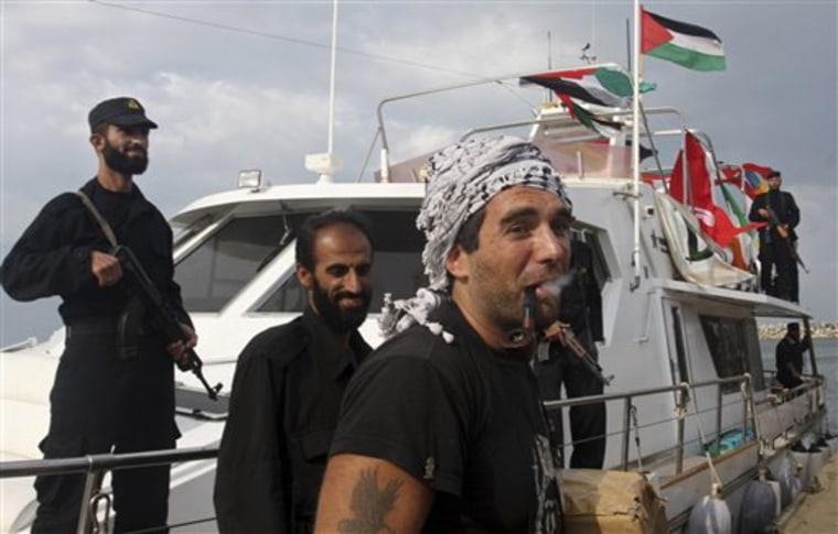 "International activist Vittorio Utmpio Arrigoni, from Italy, carries an aid box from the ""Free Gaza"" boat after its arrival at the Gaza City port in this Oct. 29, 2008 file photo."