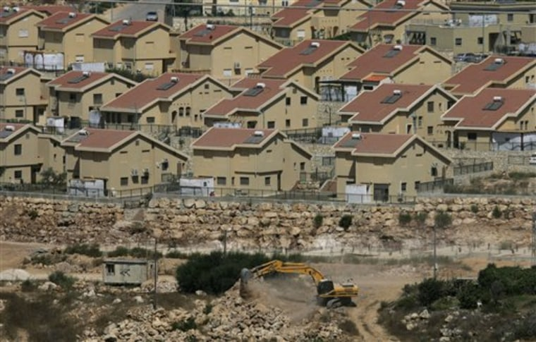 Israeli earth-moving equipment works in the Jewish settlement of Kiryat Netafim, near the West Bank village of Salfit. Top Palestinian official Saeb Erekat said Wednesdaythat Palestinians will ask the U.N. Security Council in the coming days to condemn Israeli settlement construction.