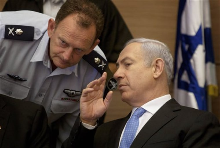 Israeli Prime Minister Benjamin Netanyahu, right, listens to his military advisor Maj. Gen. Yohanan Locker, as he attends a meeting Monday of the Foreign Affairs and Defense Committee, in the Knesset, Israel's parliament in Jerusalem.