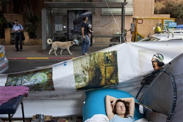 A woman sleeps in a protest tent encampment against the costs of living in Tel Aviv, Israel, on Aug. 2. What started out as a sprinkling of tents pitched along Tel Aviv's tony Rothschild Boulevard — named for a scion of the fabulously wealthy Jewish banking family — has swollen into the most ferocious popular outcry in decades. Initially targeting soaring housing prices, it quickly morphed into a sweeping expression of rage against a wide array of economic issues