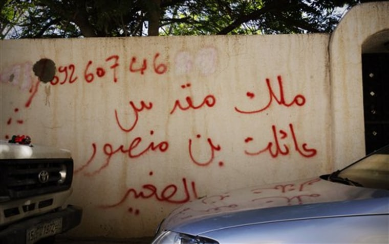 "Graffiti on the wall of a house reads in Arabic, ""house of bin Mansour,"" in Tripoli, Libya. Across the city, gunmen have turned up at houses demanding ownership — a sign of the post-revolutionary disorder rattling this oil-rich nation."