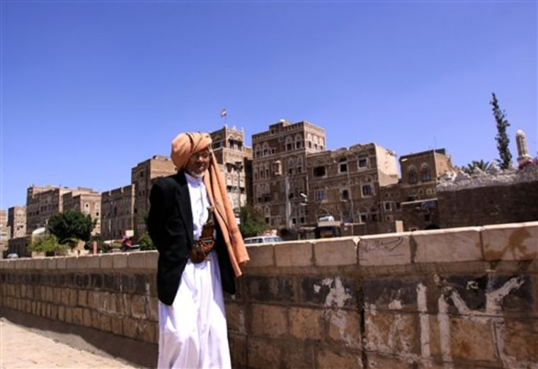 An unidentified Yemeni man walks near Saba Institute, an Arabic language school seen in background, in the Yemen capital of  San'a on Sunday. Al-Qaida in Yemen, suspected in the thwarted mail bombing attempt, appears to be aggressively seeking to recruit American and European radicals who could provide an entry way for the group to carry out attacks in their homelands.