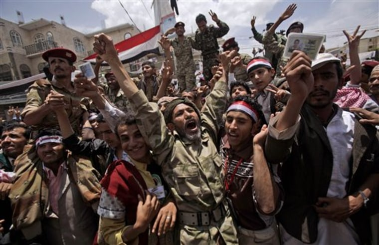 A Yemeni army officer, center, reacts as he and other officers join anti-government protesters in Sanaa, Yemen, Sunday.