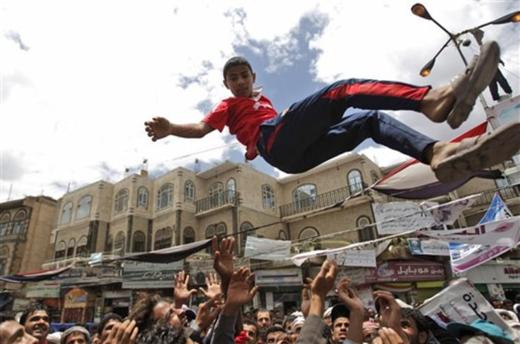 Anti-government protesters reach up to catch a youth after throwing him into the air during a demonstration demanding the resignation of Yemeni President Ali Abdullah Saleh, in Sanaa, Yemen, on May 21.