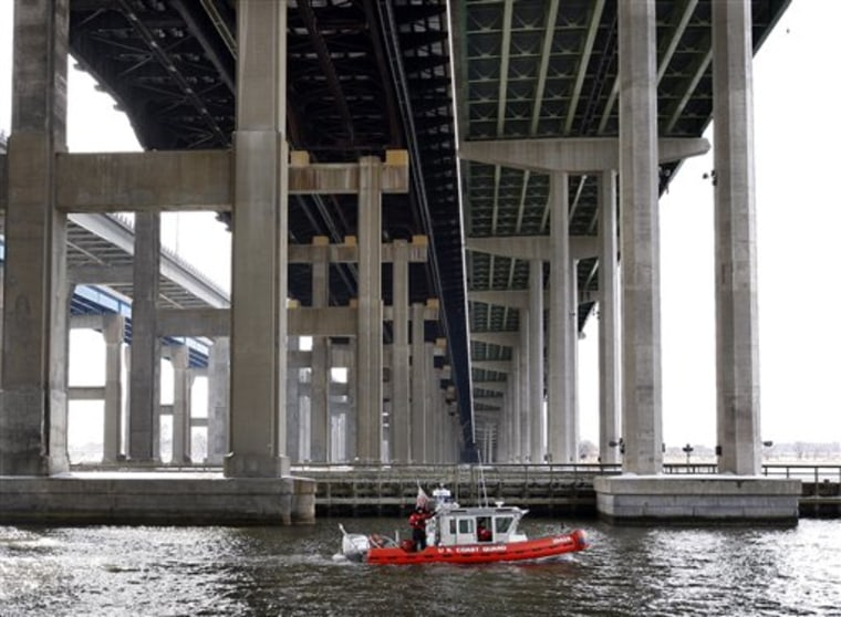 A U.S. Coast Guard boat searches the Raritan River under the Driscoll Bridge Wednesday, Feb. 17, 2010, near Sayreville, N.J., for a 3-month-old girl after her father said he threw the infant  off the bridge and into the river.