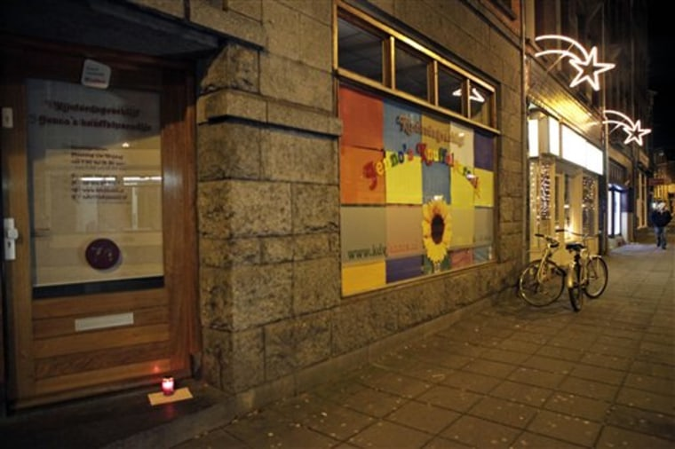 A lone candle with a note stands Sunday in the doorway of a daycare center in Amsterdam, where a man suspected of abusing preschool children was employed. Parents of dozens of preschool children in Amsterdam have been warned their children may have been abused by a baby sitter in one of the worst sexual abuse cases to come to light in the Netherlands. Authorities say a 27-year-old suspect was arrested after a tip from U.S. authorities about child pornography. The man's computers have been seized and he has confessed to dozens of sex crimes at two Amsterdam daycare centers over the past 18 months, police chief Herman Bolhaar said at a press conference Sunday.