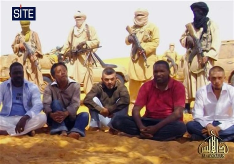 This image taken from video and provided by U.S.-based SITE Intelligence Group shows the first images of a group of foreign hostages working for a French energy company who were seized in Niger two weeks ago by an al-Qaida offshoot, according to the group that monitors terrorism. The hostages were grabbed in the middle of the night on Sept. 16 from their guarded villas in the uranium mining town of Arlit in Niger where they worked for French nuclear giant Areva. Five are French citizens, the other two are from Togo and Madagascar.
