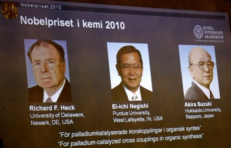 Portraits on an overhead screen show American Richard Heck and Japanese researchers Ei-ichi Negishi and Akira Suzuki, who won the 2010 Nobel Prize in chemistry, during Wednesday's announcement at the Royal Academy of Sciences in Stockholm, Sweden.