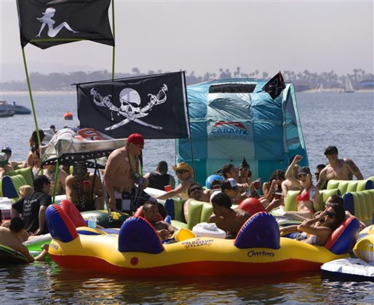 "Revelers show up for the floating party off Fanuel Street Park in Pacific Beach dubbed ""Floatopia."" on March 20, 2010 in San Diego.  San Diego's City Council may let the air out of so-called ""floatopia"" parties where people booze it up on inner tubes offshore. The council meets Monday afternoon to consider closing a loophole in the city's ban on the beach use of alcohol.  (AP Photo/San Diego Union-Tribune, Nelvin C. Cepeda)    ** SAN DIEGO COUNTY OUT, NO SALES, COMMERCIAL INTERNET OUT, FOREIGN OUT,  MANDATORY CREDIT, TV OUT **"