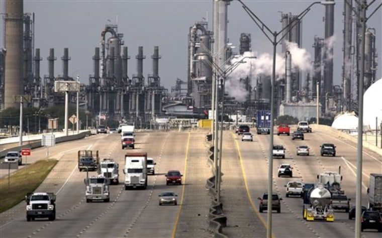 Shell Oil Company's Deer Park refinery and petrochemical facility is shown in the background as vehicles travel along Highway 225 in Deer Park, Texas.
