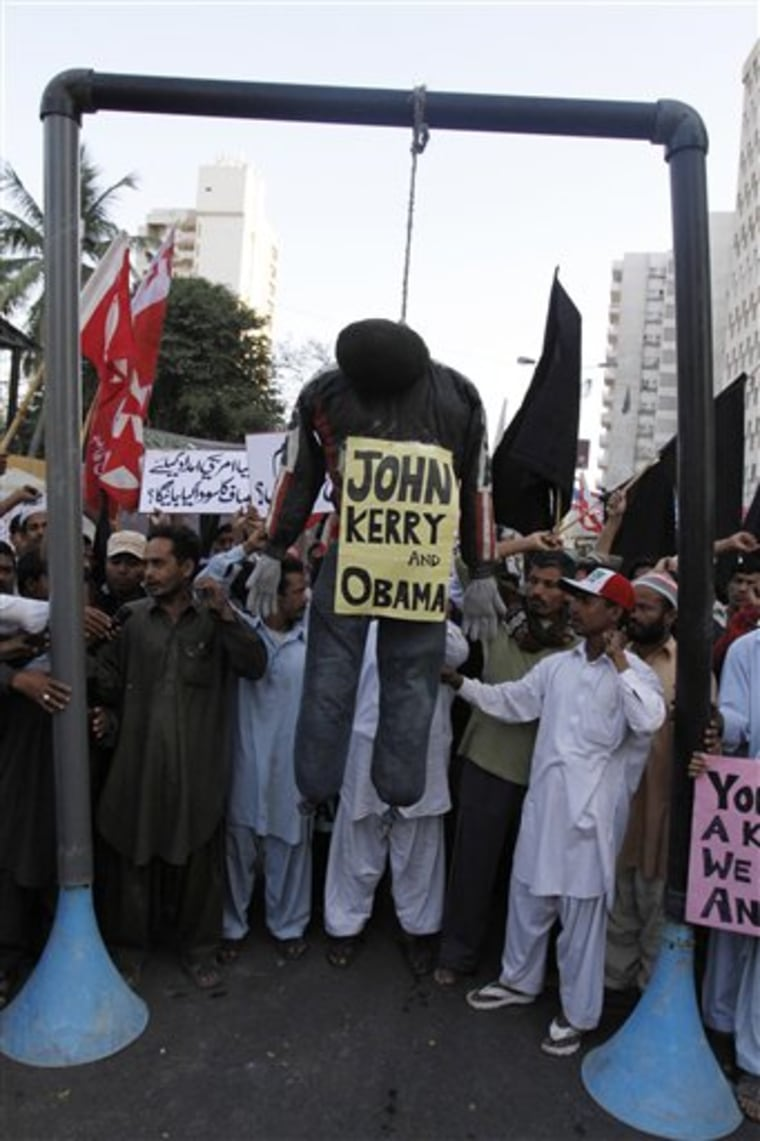 Supporters of Pakistani religious party Jammat-e-Islami hang an effigy during a protest against the visit of U.S. Sen John Kerry and a statement by U.S. President Obama regarding release of a U. S. consulate employee Raymond Davis.