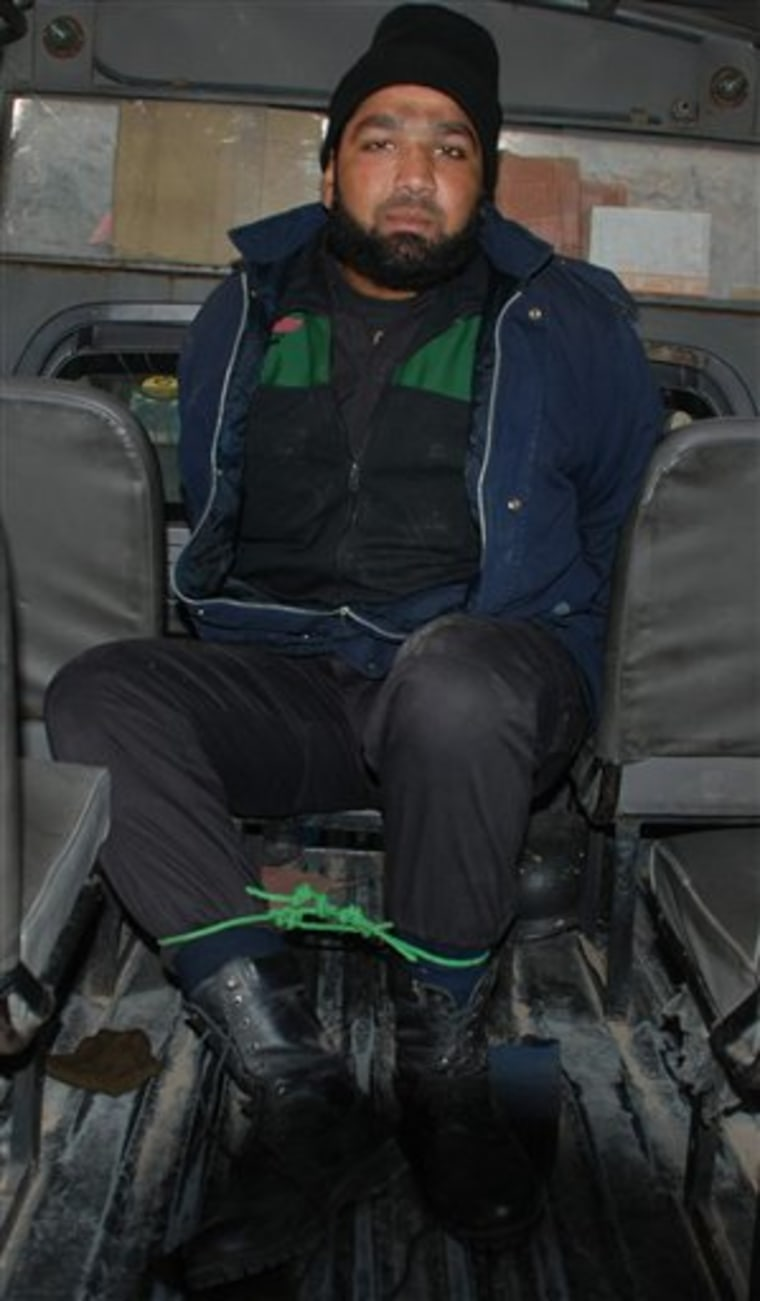 Mumtaz Qadri, who allegedly killed Punjab Governor Salman Taseer, sits in a police van in Islamabad, Pakistan, on Tuesday.