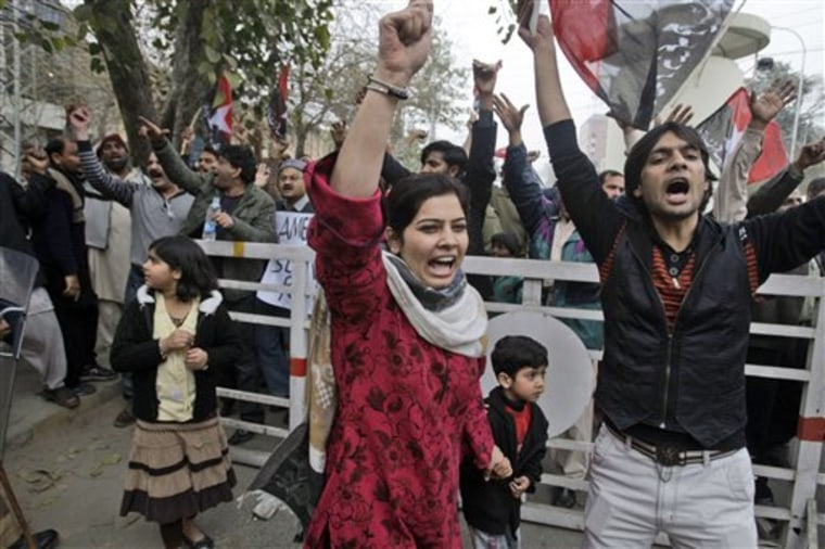Pakistani demonstrators shout slogans during a rally against a U.S. consular employee, suspected in a shooting, in Lahore, Pakistan, Sunday.