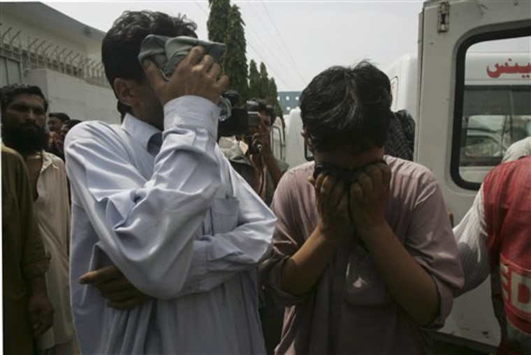 Relativesmourn the death of a family member who was shot dead in Karachi, Pakistan on Wednesday, July 6. Renewed violence in Karachi killed at least 10 people and left many injured, police said.