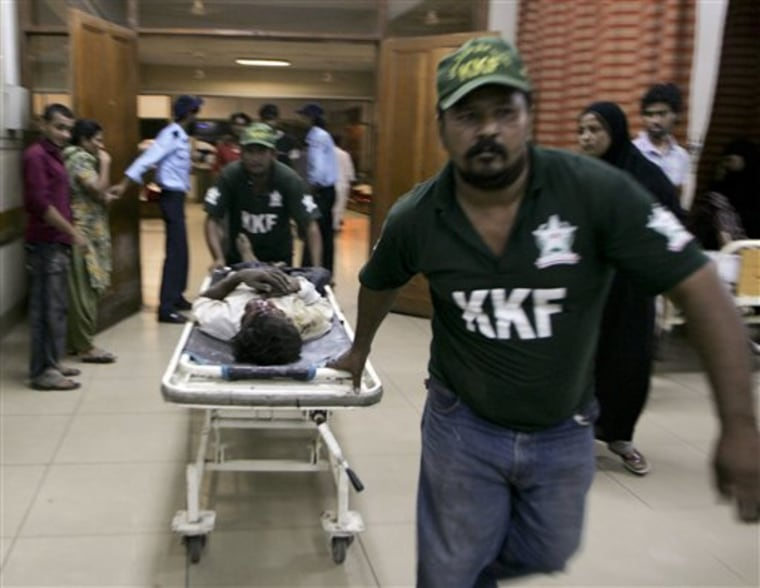 A shooting victim is brought to a local hospital in Karachi, Pakistan on Saturday. Gunmen have killed at least 21 people in Karachi in the past 24 hours, raising tensions in Pakistan's largest city as voters headed to the polls Sunday to elect a replacement for a provincial lawmaker assassinated earlier this year.