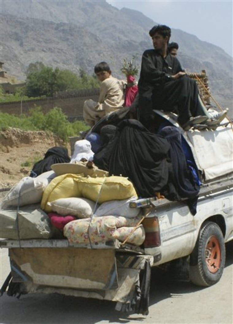 Pakistani tribal families flee their villages, passing through the Khyber area, Tuesday, April 12,in Pakistan. Violent clashes continue in Tirah Valley.