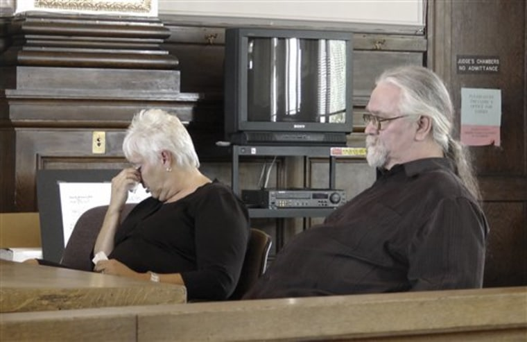 Phillip Seaton, right, and his wife Deborah are shown Monday in the courtroom in Shelbyville, Ky.