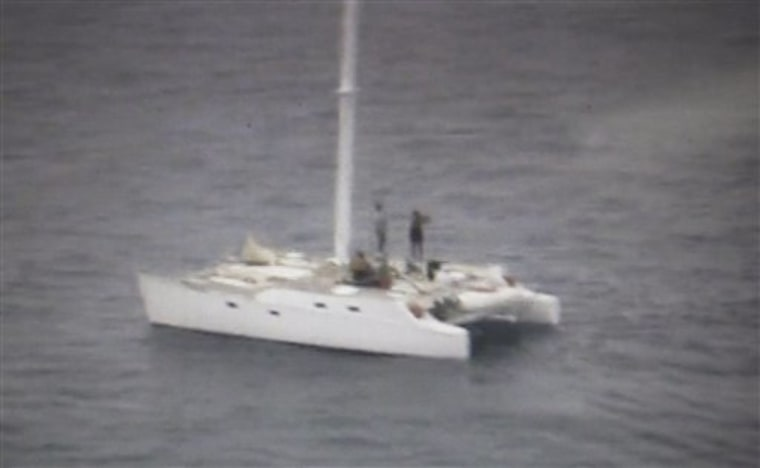 "This still image from video released by the Philippine coast guard, shows American occupants on board the 38-foot catamaran ""The Pineapple"" as they wait to be rescued off the southern island of Dinagat, Philippines, on Sunday Jan. 23."