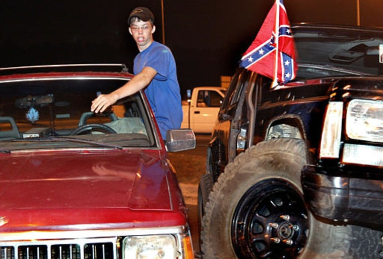 """Teenager J.C. Matthews enjoying a Saturday night hang-out in a parking lot in downtown Buford, Ga., last month.Matthews said """"before the price of gas jacked to two dollars per gallon this lot would of been full with teens and cars."""""""