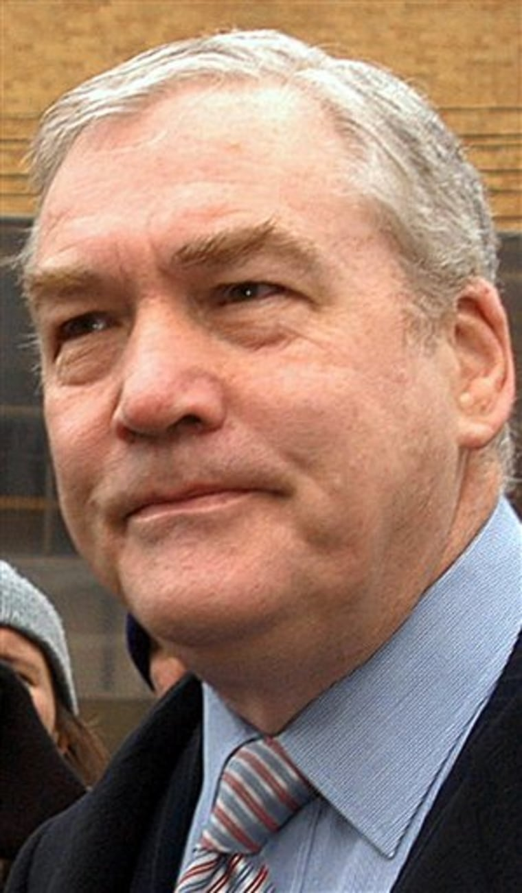 "Conrad Black, former CEO and chairman of Hollinger International, enters the New Castle County Courthouse in Wilmington, Del., earlier this year. Hollinger was ""systematically manipulated"" by its controlling shareholders, according to a report filed Tuesday with the Securities and Exchange Commission."