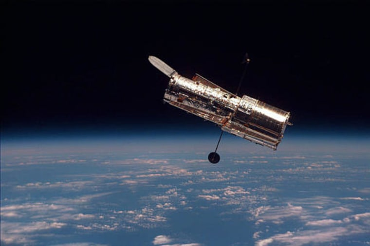 This picture of theHubble Space Telescope was snapped from the shuttle Discovery during a 1997 servicing mission. NASA has decided to discontinue such servicing missions due to safety concerns.