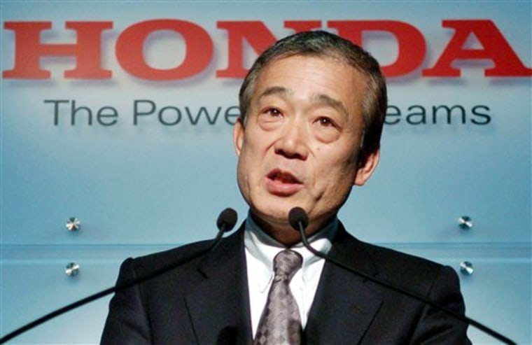 Takeo Fukui, chief executive of Honda Motor Co., is seen announcing the automaker's new mid-term business strategy in Tokyo Thursday.